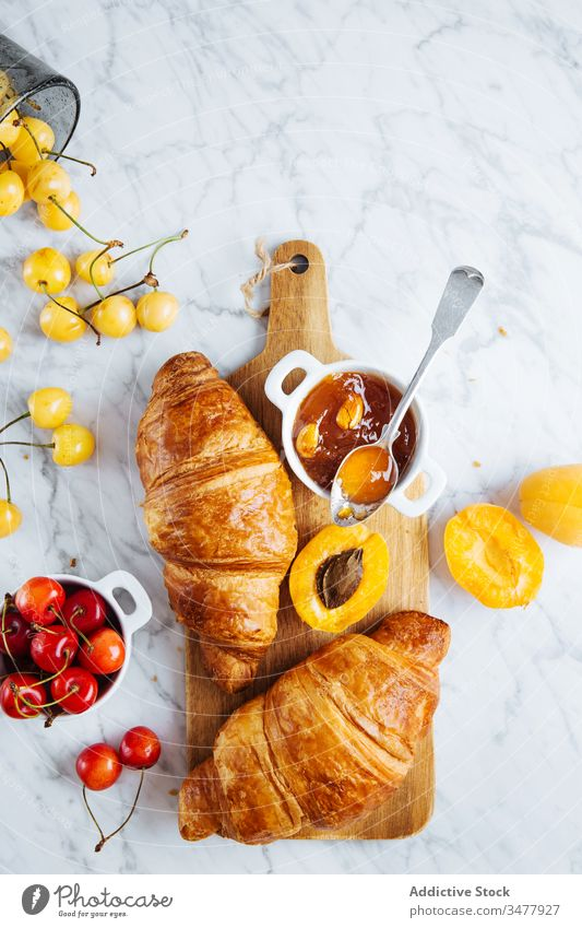 Croissant and apricot jam on wooden board croissant pastry breakfast bake fresh natural morning food serve delicious tasty meal tradition gourmet nutrition