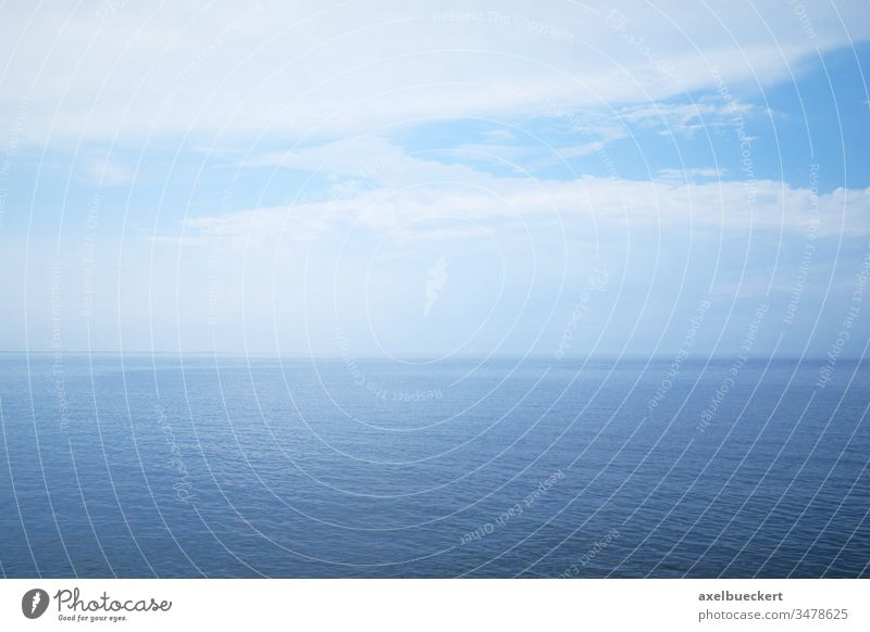 open sea and cloudy sky background water ocean horizon seascape hazy day blue nature overcast north sea german germany copy space copyspace nobody tranquility