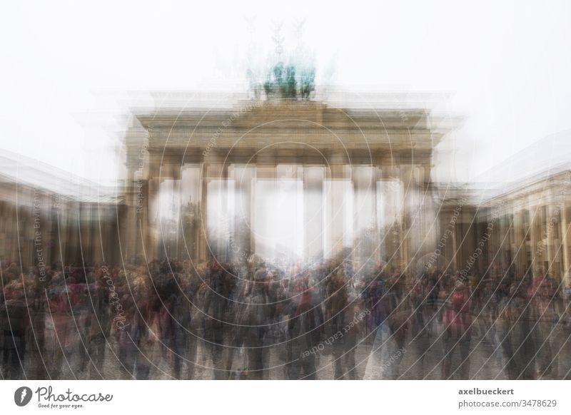 multi exposure of Brandenburg Gate with tourist crowd in Berlin Germany brandenburg gate berlin germany brandenburger tor landmark tourism unrecogniazble group
