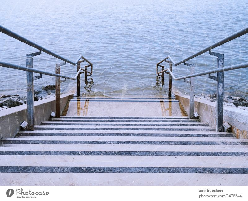 concrete stairs leading into water steps sea ocean staircase stairway river lake descent down blue perspective outdoor nature outdoors nobody coast architecture