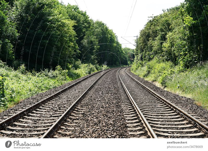 empty railroad railway or train tracks background with copy space travel concept journey traveling voyage trip transportation wanderlust travel bug distance