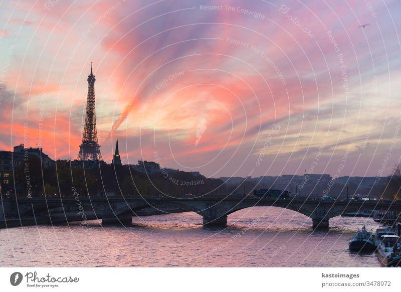 Sunset over Eiffel Tower and Seine river. paris eiffel city tower france seine bridge famous eiffel tower water sky capital travel architecture french european