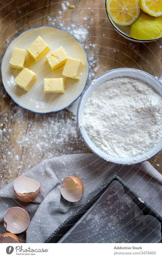 Ingredients for cake recipe on table powdered with flour ingredient butter eggs bake lemon food preparation bakery homemade making kitchen cuisine rustic dough