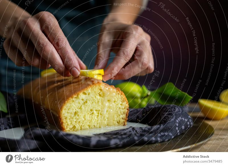 Anonymous person preparing homemade lemon cake pastry baking confectionery dough kitchen gourmet cloth fruit sugar cooking table natural recipe culinary rustic