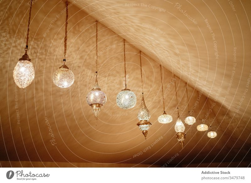 Traditional glowing lamps in interior of tent lantern oriental design light morocco illuminate tradition hang bright ceiling ornament culture marrakesh style