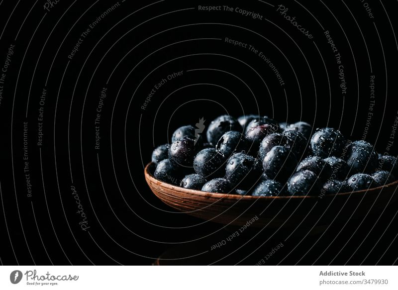 Fresh blueberries on wooden bowl on table blueberry dark food fresh natural ripe delicious tasty ingredient healthy nutrition vegetarian vitamin raw meal