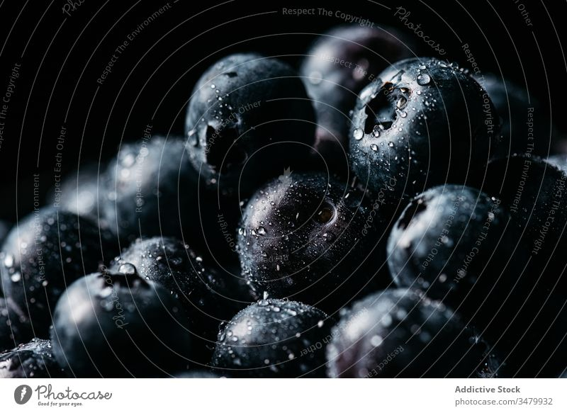 Fresh blueberries on wooden bowl on table blueberry dark food fresh natural ripe delicious tasty ingredient healthy nutrition vegetarian vitamin raw cuisine