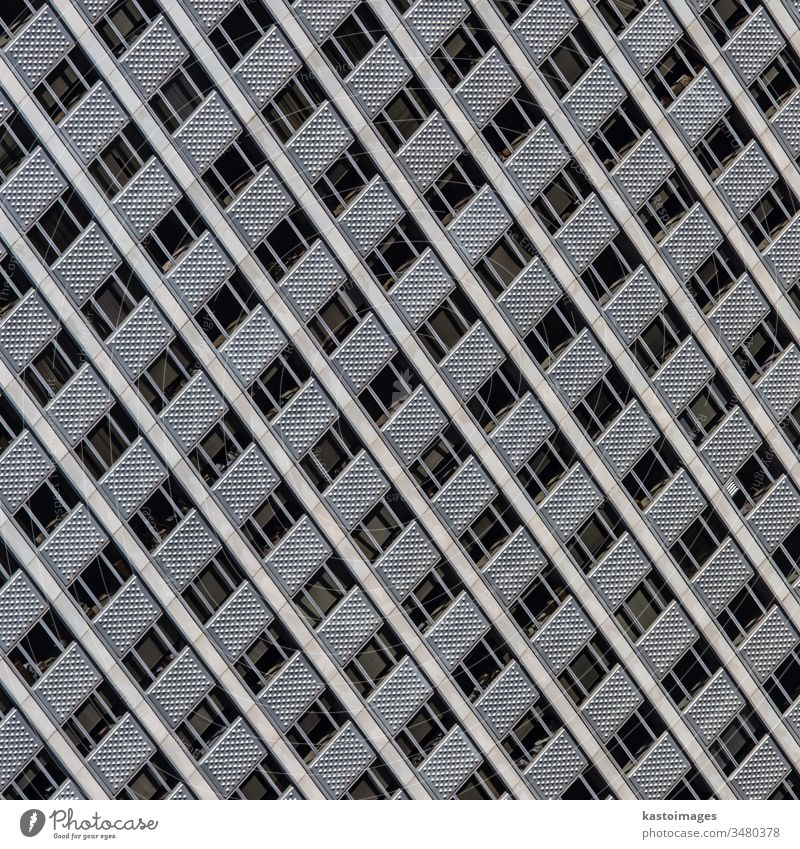 Windows of a modern office building. architecture facade windows pattern steel background construction glass design estate exterior futuristic high light urban