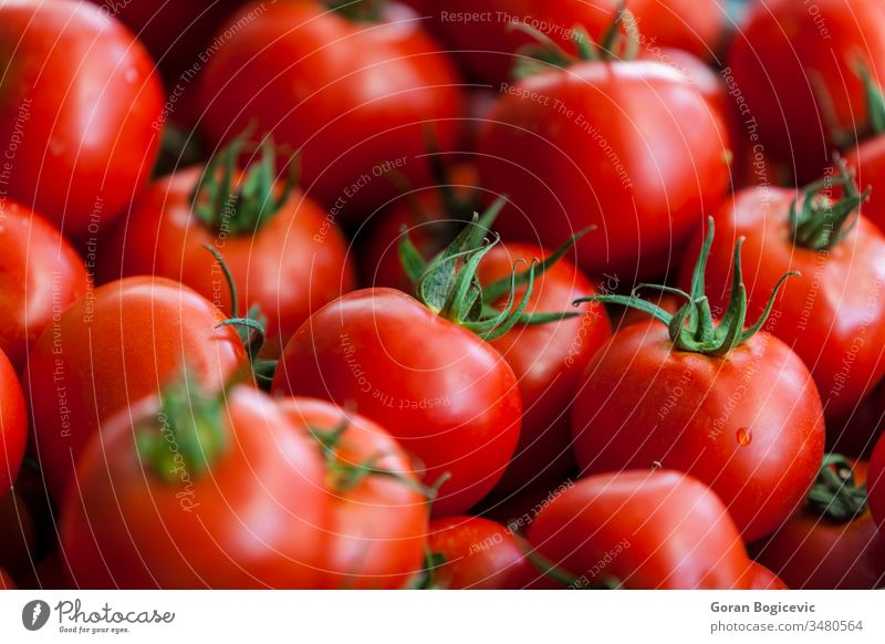 Tomatoes closeup whole white nature natural agriculture fresh food raw nobody healthy ingredient nutrition pile organic tomato vegetable vegetarian group heap