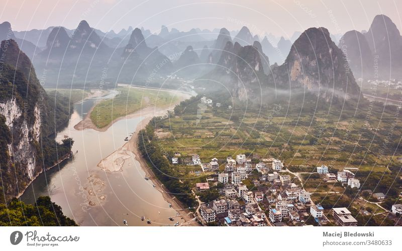 Karst landscape with Li River at sunset, China. karst Asia travel Xingping aerial beautiful dusk mountains nature picture river rural scenery scenic sky tourism