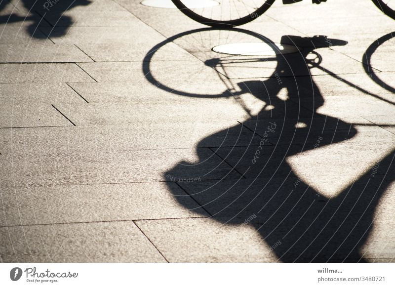 Shadow of a cyclist Cycling Leisure and hobbies Sports Human being Athletic recreational sport Bicycle Shadow play