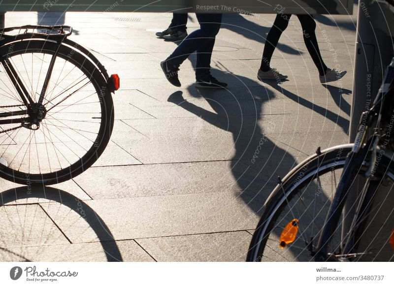 shading of free-wheeling legs in the pedestrian zone in search of a good bike pedestrian shades people Bicycle City life Legs Going Walking Shadow bicycles