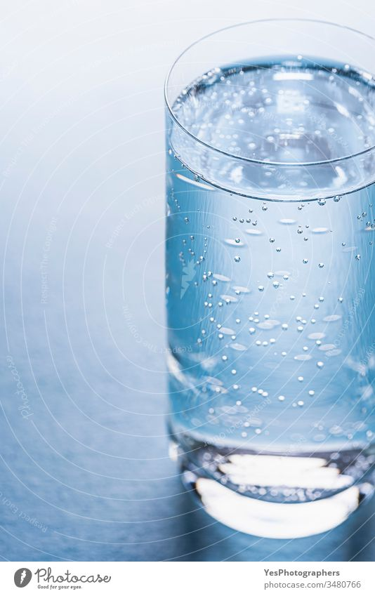 Glass of tonic water on blue background. beverage bubbles classic cold drink cold water cool diet drinking glass drinks fizzy fluid fresh full glass of water