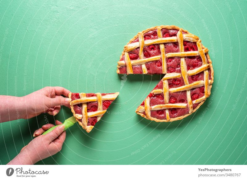 Grabbing slice of cake. Raspberry pie with lattice top american baked bakery berries classic confectionery copy space crusty cut out decoration delicious