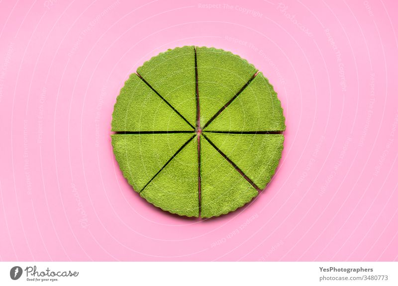 Sliced matcha cheesecake on pink background. Japanese green tea dessert above view colorful confectionery creamy cutout delicious equal portions flat lay food