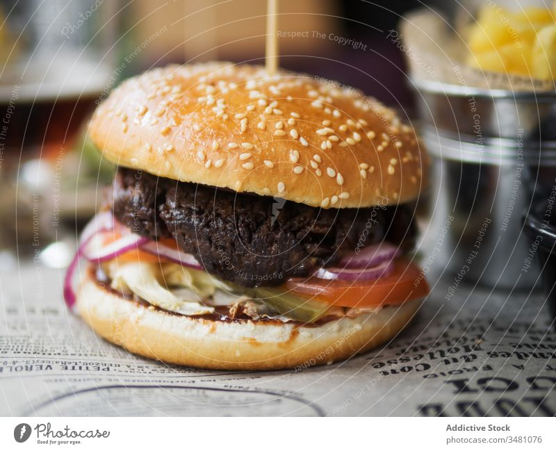 Tasty hamburger served in restaurant beef delicious fast food lunch dinner table meal meat snack cuisine tasty bun junk dish classic sesame bread appetizing
