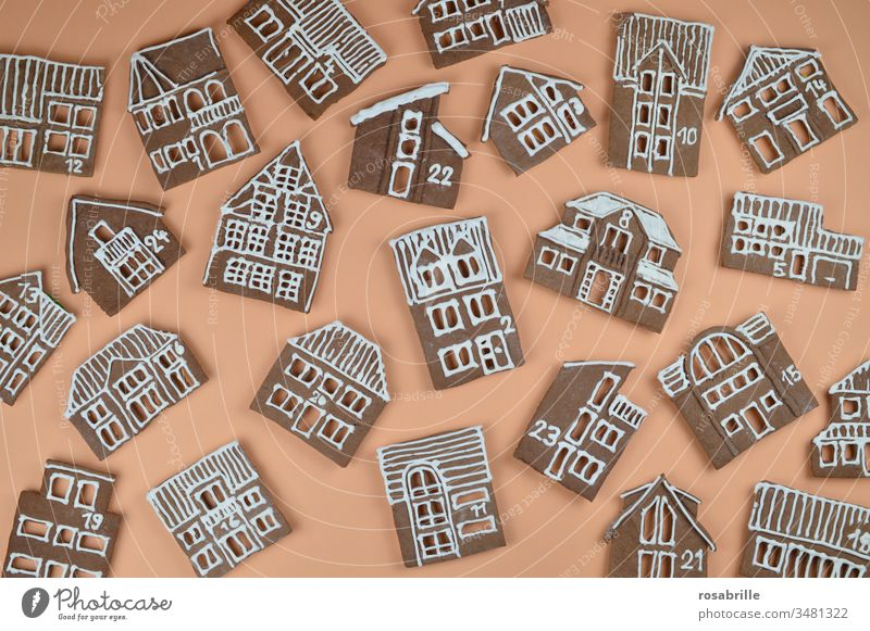 Gingerbread Advent calendar homemade with house facades jumbled up on orange | anticipation Gingerbread houses Christmas bakery Baking Town Village Orange
