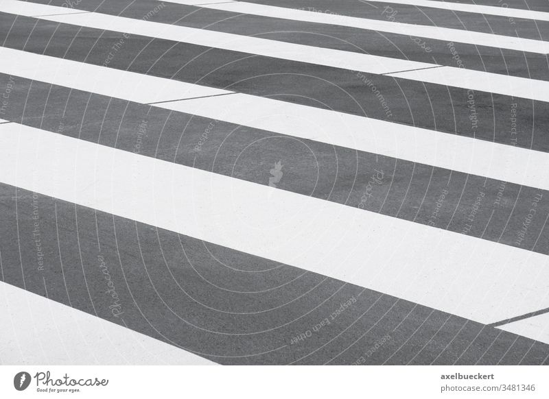 close-up zebra crossing or crosswalk background asphalt road marking street stripe stripes striped stripy gray grey tarmac lined abstract pattern empty nobody