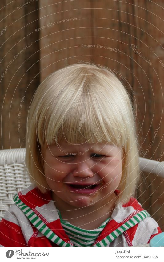 But I want Girl Grimace fringe hairstyle Portrait photograph Natural little girl Child Face Infancy Sadness Cry wounded gloom Cute Parenting Wood Sweet Day
