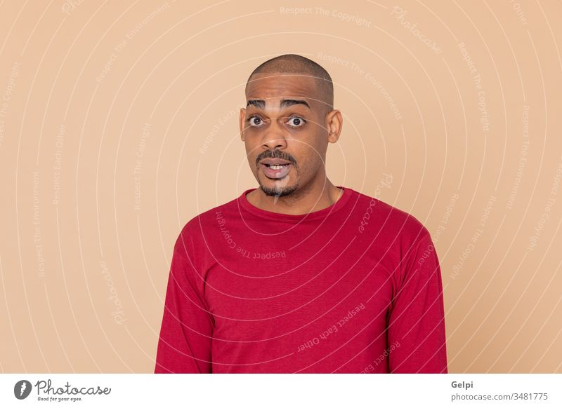 African guy with a red jersey black yellow shy surprised excited admiration surprise adult people person african male american man isolated background white