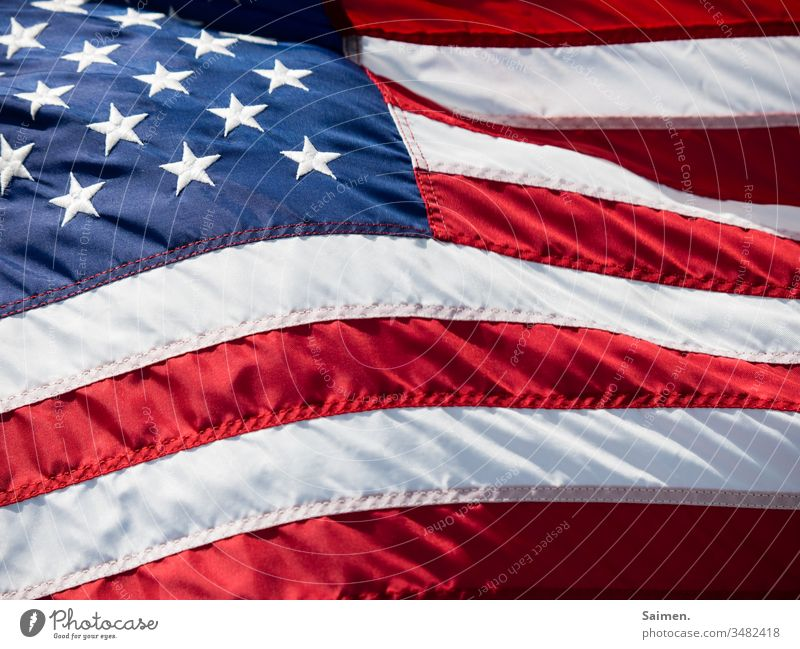 Stars&Stripes Americas flag Flag USA Wind Blow Colour photo stars Lines and shapes seams Red Blue Freedom White Independence patriotically Symbols and metaphors