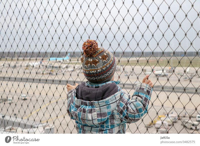 Child at the fence of the airport barrier with a view of the airport airfield Airport out vacation Airplane Fence Vacation & Travel Aviation Sky Clouds Flying