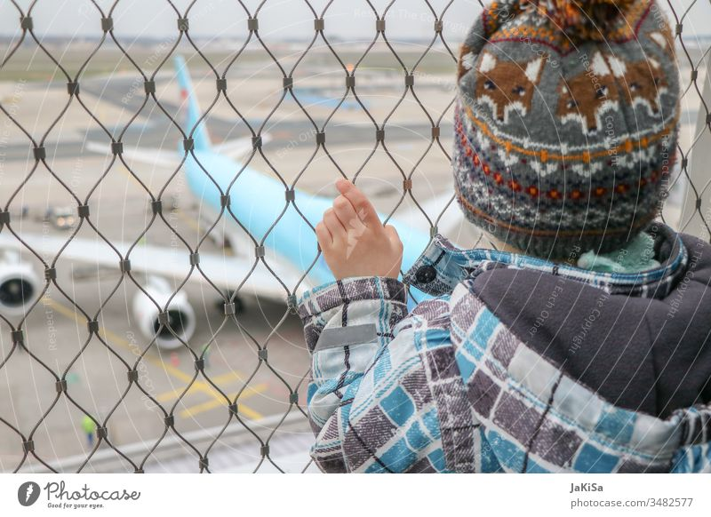 Child at the fence of the airport barrier with a view of a plane on the airfield Human being Airplane Vacation & Travel Aviation Sky Flying Exterior shot