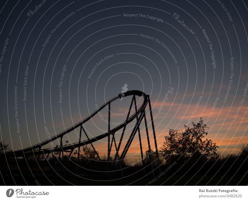Roller coaster at sunset roller coaster ride Sunset Emotions emotionally emotional rollercoaster rollercoaster of emotions moody Atmosphere atmospherically