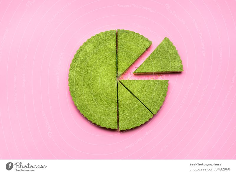 Matcha tart cut in slices. No baking cheesecake. Matcha dessert above view colorful confectionery creamy cutout delicious equal portions flat lay food