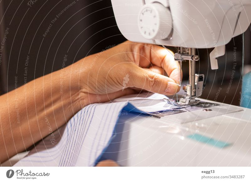 Sewing machine worked by a seamstress Work Working arms artistic buttons clipping concentration create creativity designer designing details efficiency females