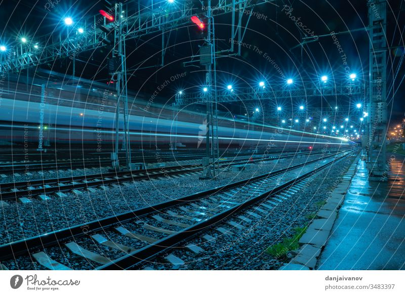 Long-exposure photograph night rail way .Moscow train railway city traffic railroad light transportation speed track travel station street highway rails urban