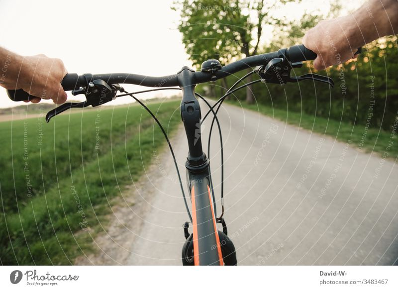 By bicycle a bicycle tour overland Bicycle Cycling tour off the beaten track Lanes & trails Driving Bicycle handlebars Steering Right ahead hands To hold on