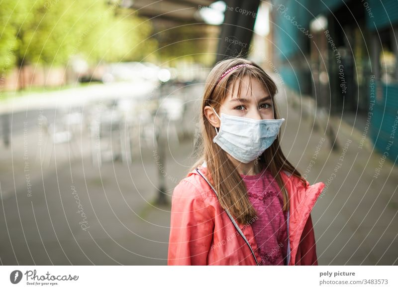 Portrait of a young girl wearing a protective mask, biological danger from coronavirus: Covid-19 danger person Epidemic Protection Virus flu