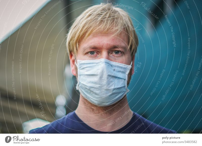 Coronavirus: danger of Covid-19. Portrait of a young man wearing a face mask, biological danger person Epidemic Protection Virus flu Environmental pollution