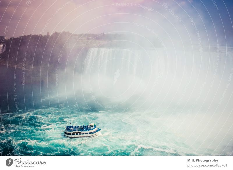 Horseshoe Falls from the Canadian side. Scenic view of Niagara Falls. Waterfall Colour photo Exterior shot Attraction Maid of the Mist Canada Rainbow