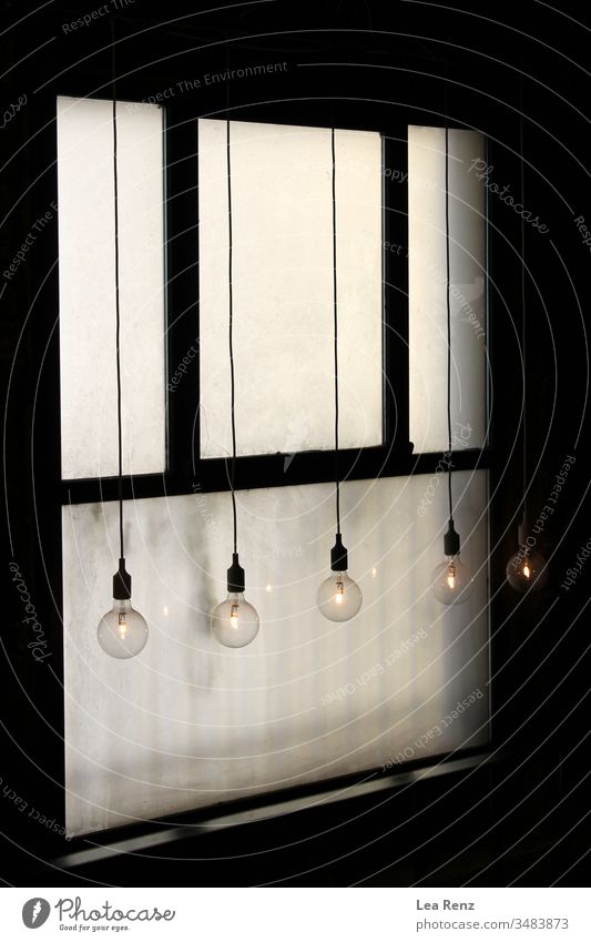 Lightbulbs hanging in front of an old window. lightbulbs design white metal door wall power electric home equipment isolated box security control button panel