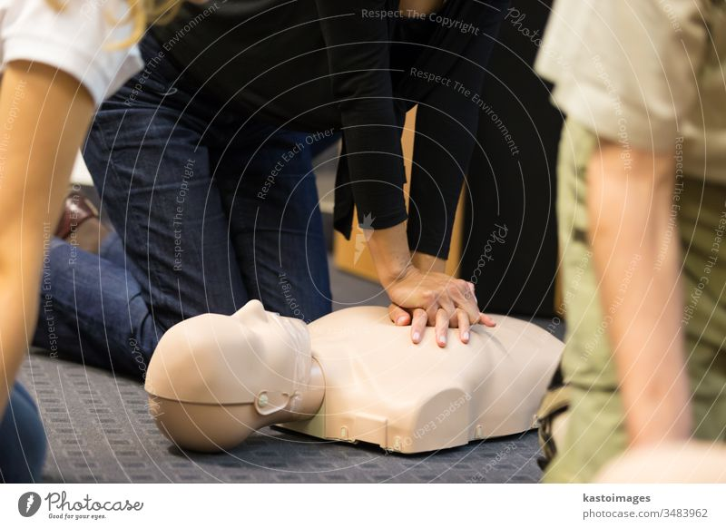 First aid CPR seminar. emergency training procedure first aid medical cpr paramedic medicine doctor life saving doll patient people dummy care instructor