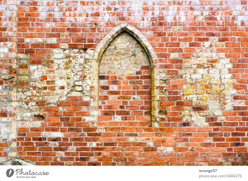 Bricked up pointed arch in a brick wall Ogival arch Ogival windows bricked up Bricked opening Wall (barrier) Wall (building) Deserted Colour photo Exterior shot