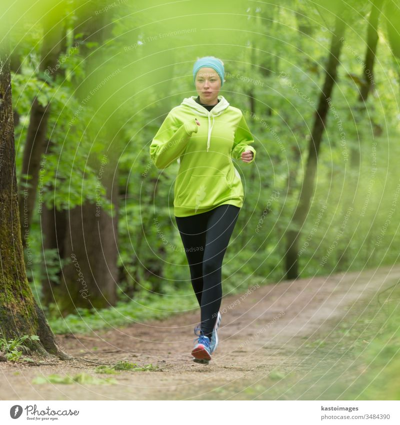 Sporty young female runner in the forest. active sport woman girl exercise fit activity person lifestyle sporty recreation workout athletic outside jogger