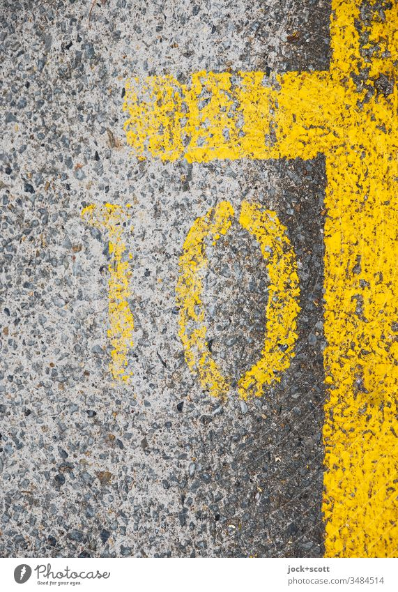 Number 10 next to the yellow parking space markings Symmetry Ground markings Ravages of time Under Gray Line Simple Structures and shapes Detail Marker line
