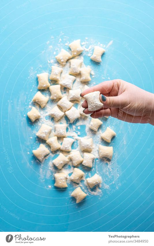 Cheese gnocchi uncooked in chef hand. Fresh gnocchi dumplings pile Italian above view blue cheese cooking cuisine diet dinner european flat lay flour food fresh