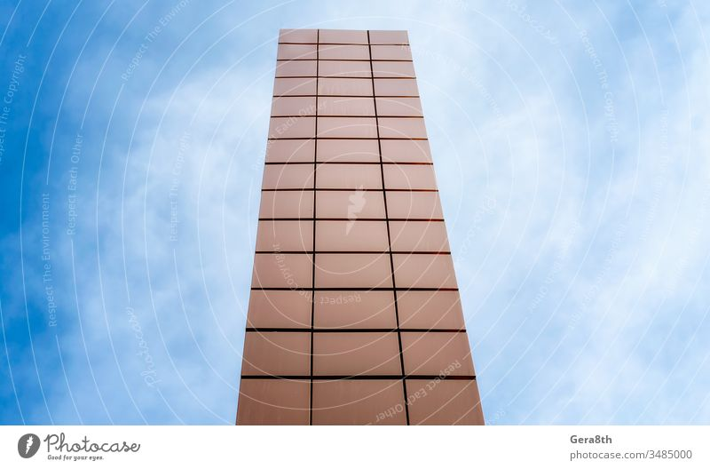 high tower on a background of blue sky and clouds abstract architecture block building city color geometry line modern orange perspective rise shape skyscraper
