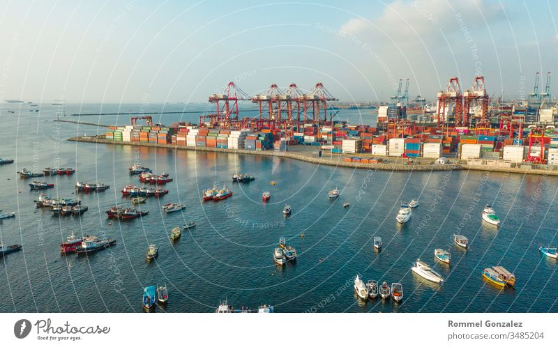 View of dock and containers in the port of Callao, Lima / Peru drone view aerial photography aerial view freighters carrying unloading by-ship platform