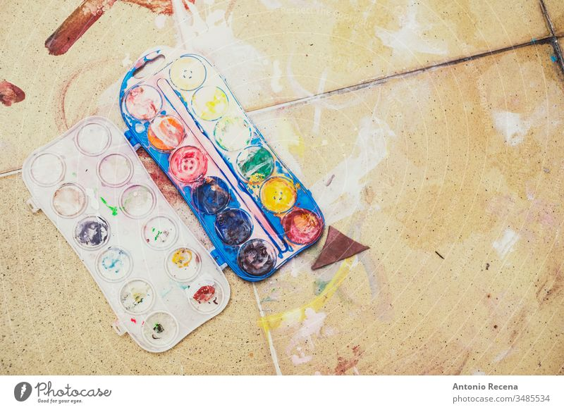 background of watercolors on the dirty paint floor painting nobody soil art plastic drawing tempera object messy realistic high angle view still life