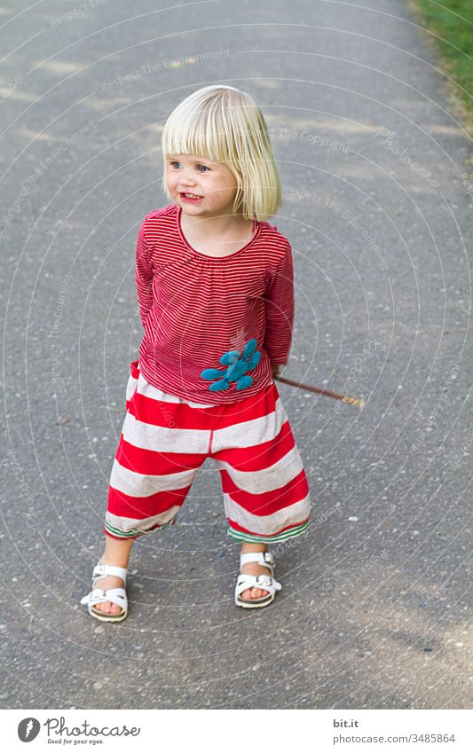 Search dog to catch a stick. girl Child Laughter Joy Toddler Playing smile luck Small Happiness Infancy Cheerful Cute already Lifestyle Stick Stripe