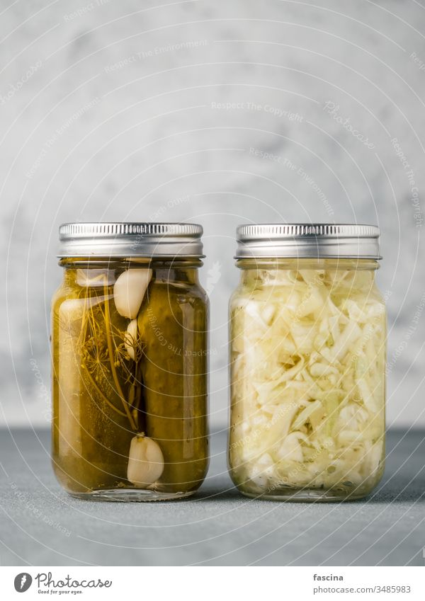 Glass jar with pickled cucumbers, copy space dill sauerkraut marinated canning green glass vegetable above salted wild whole vinegar lebanese eating spicy