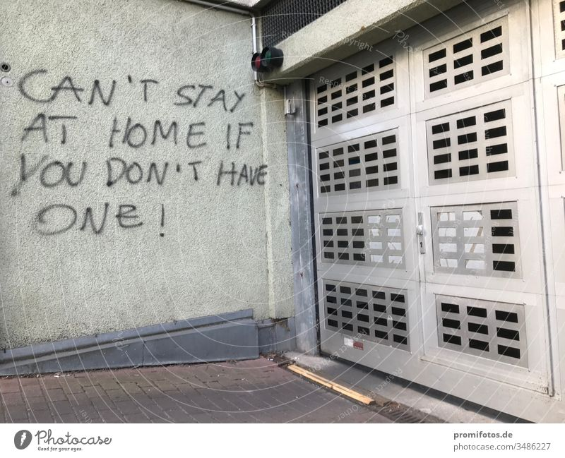 "Graffiti: ""Can't stay at home if you don't have one"" / Photo: Alexander Hauk protest Demonstration Wall (building) house wall Garage garage entrance policy"