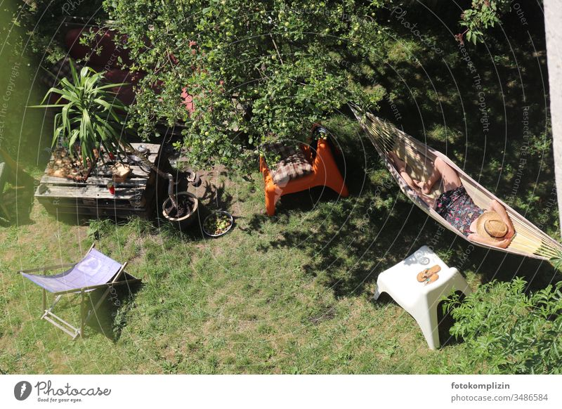 View from above of woman in hammock in the garden Woman midday nap Doze chill feel good Joie de vivre (Vitality) Relaxation Contentment Lie Calm Break Sleep