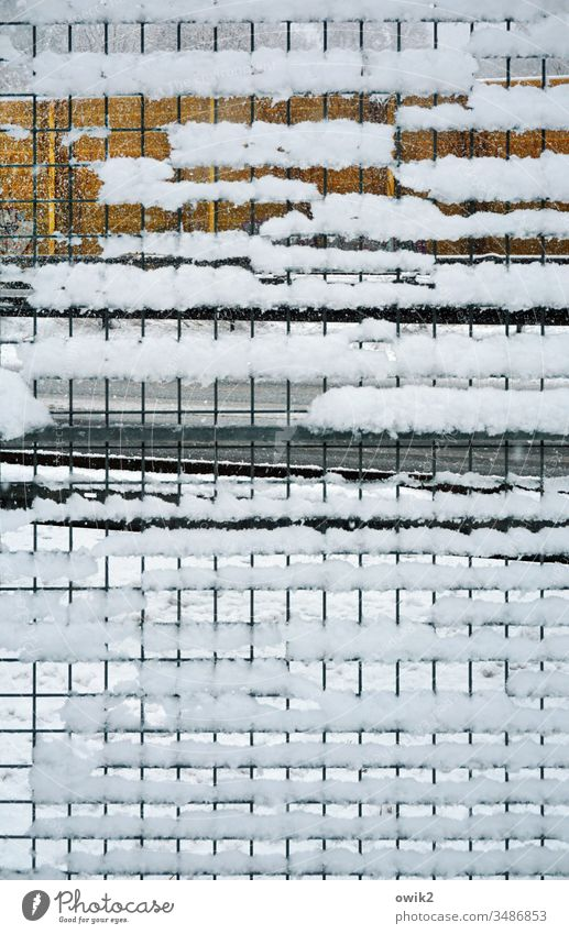 Motorway strip Grating Door Fence Metal Snow snowed over Highway Roadside Mysterious