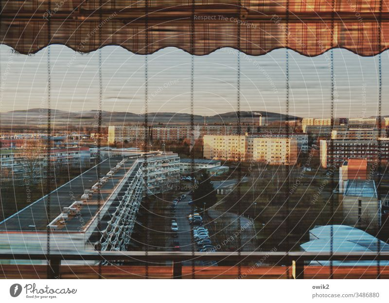 Sleeping city Window view outside Panorama (View) Overview balustrade rail Venetian blinds slats Prefab construction blocks of flats Balconies Colour photo